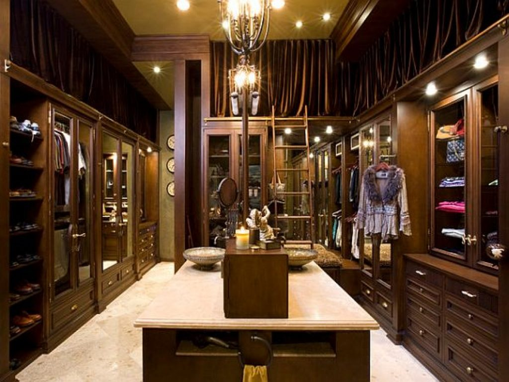 luxury dark wood modern walk in dressing room with chair custom closet design