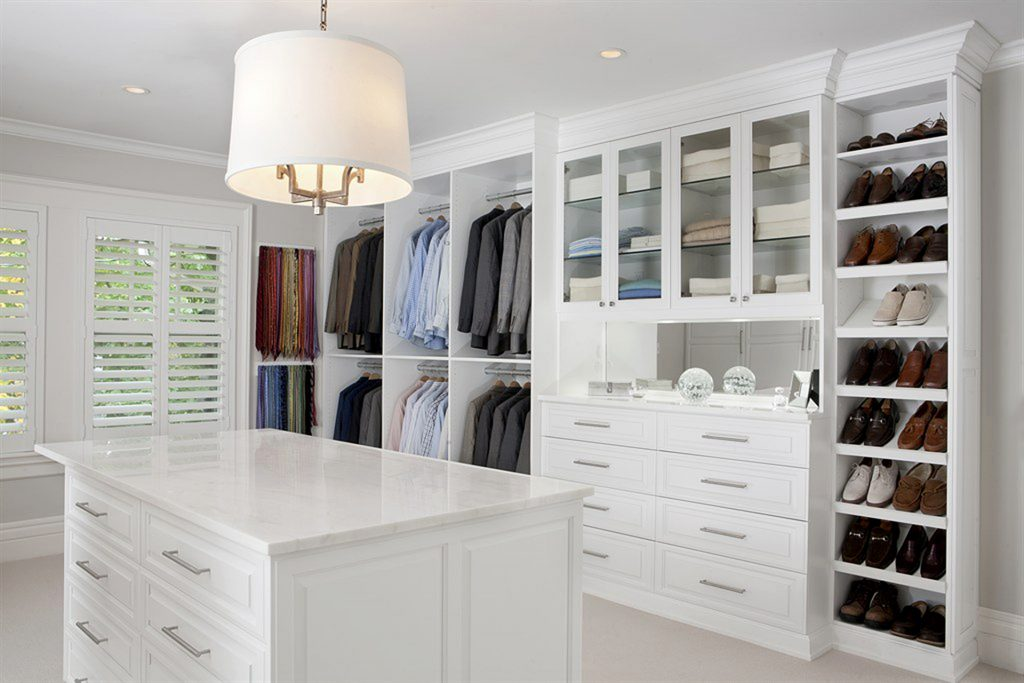 luxury white custom closet design with island